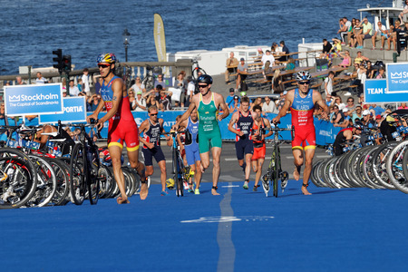 mario: STOCKHOLM, SWEDEN - AUG 23, 2015: Triathletes Mario Mola and Alarza running with bicycles in the transition zone in the Mens ITU World Triathlon series event August 23, 2015 in Stockholm, Sweden