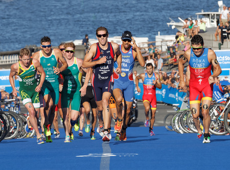 gomez: STOCKHOLM, SWEDEN - AUG 23, 2015: Dramatic scene of a group of running triathletes including the leader Javier Gomez wearing sun glasses in the Mens ITU World Triathlon series event August 23, 2015 in Stockholm, Sweden Editorial
