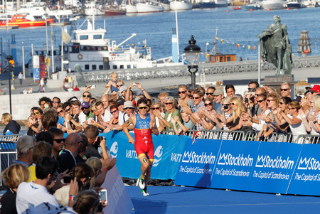 gomez: STOCKHOLM, SWEDEN - AUG 23, 2015: Triathlete Javier Gomez Noya a few meters before winning the triathlon event at the Mens ITU World Triathlon series event August 23, 2015 in Stockholm, Sweden