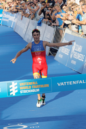 esp: STOCKHOLM, SWEDEN - AUG 23, 2015: Triathlete Javier Gomez Noya (ESP) one meter before winning the triathlon event at the Mens ITU World Triathlon series event August 23, 2015 in Stockholm, Sweden Editorial