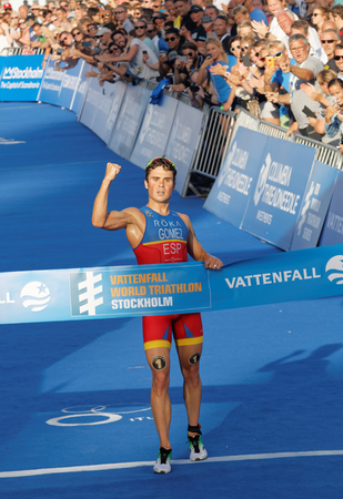 clench: STOCKHOLM, SWEDEN - AUG 23, 2015: Triathlete Javier Gomez Noya (ESP) clench a fist when winning the triathlon competition at the Mens ITU World Triathlon series event August 23, 2015 in Stockholm, Sweden