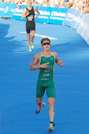 chased: STOCKHOLM - AUG 23, 2015: Running triathlete Ryan Fisher chased by Jonas Schomburg at the finish at the finish at the Mens ITU World Triathlon series event August 23, 2015 in Stockholm, Sweden Editorial