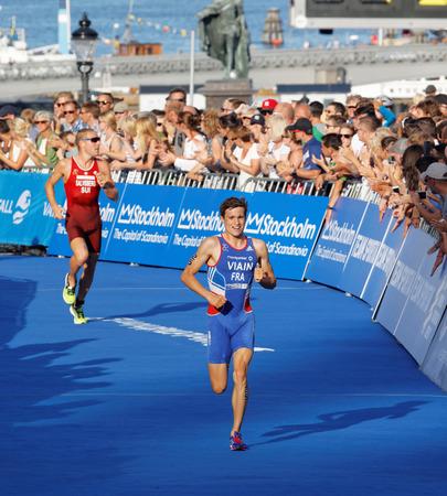 chased: STOCKHOLM - AUG 23, 2015: Running triathlete Simon Viain chased by Andrea Salvisberg at the finish at the Mens ITU World Triathlon series event August 23, 2015 in Stockholm, Sweden