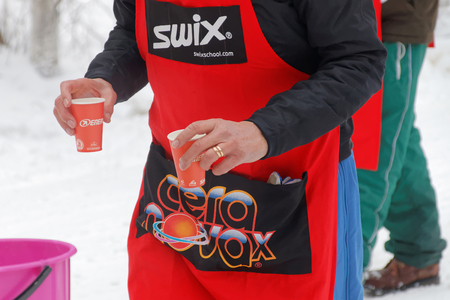 dring: STOCKHOLM - JAN 24, 2016: Official offer water to the cross country skiers at the Stockholm Ski Marathon event January 24, 2016 in Stockholm, Sweden Editorial