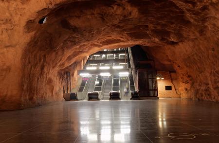 STOCKHOLM - JAN 28, 2016: The beautiful orange subway station Radhuset in Stockholm.  January 28, 2016 in Stockholm, Sweden Editorial