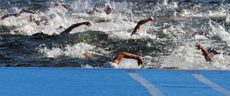 chaos: Chaos of swimming arms in the water in the Mens ITU World Triathlon series event Stock Photo