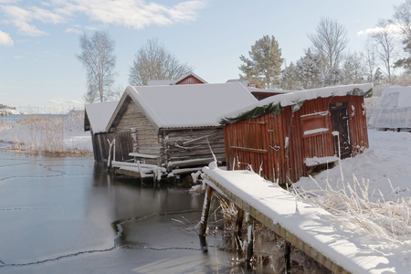 boat house: Old boat house, snow and ice in scandinavia Stock Photo