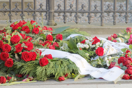 unsolved: STOCKHOLM, SWEDEN - FEB 28, 2016: Lots of roses on the grave of the murdered prime minister Olof Palme on the memorial day 30 years after the murder. February 28, 2016, Stockholm, Sweden