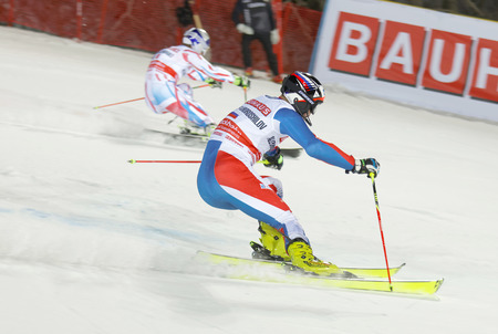 rus: STOCKHOLM, SWEDEN - FEB 23, 2016: Alexander Khoroshilov (RUS) and competitor skiing at the FIS Alpine Ski World Cup - city event February 23, 2016, Stockholm, Sweden Editorial