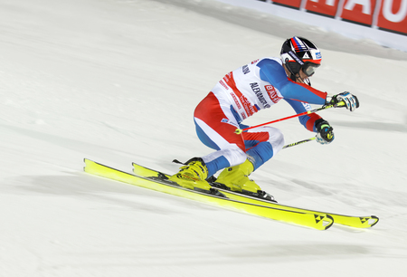 rus: STOCKHOLM, SWEDEN - FEB 23, 2016: Side view of Alexander Khoroshilov (RUS)  skiing at the FIS Alpine Ski World Cup - city event February 23, 2016, Stockholm, Sweden