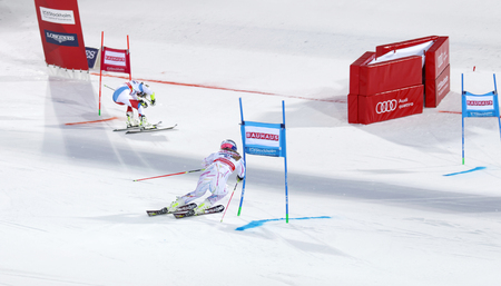 woman squirt: STOCKHOLM, SWEDEN - FEB 23, 2016: Lindsey Vonn (USA) and competitor skiing at the finish at the FIS Alpine Ski World Cup city event February 23, 2016, Stockholm, Sweden