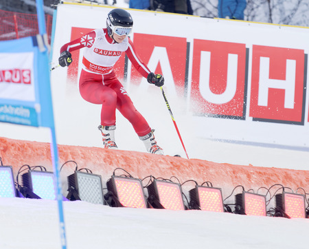 fis: STOCKHOLM, SWEDEN - FEB 23, 2016: One female skiier in red at the FIS Alpine Ski World Cup - city event February 23, 2016, Stockholm, Sweden