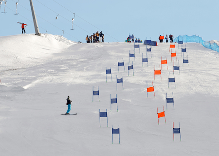 parallel world: STOCKHOLM, SWEDEN - FEB 23, 2016: Slalom slope Hammarbybacken with colorful orange and blue gates at the FIS Alpine Ski World Cup - city event February 23, 2016, Stockholm, Sweden Editorial