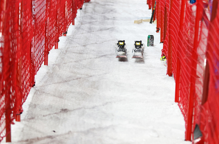 skie: STOCKHOLM, SWEDEN - FEB 23, 2016: Pair of slalom skis and red fences, front view at the Audis FIS Alpine Ski World Cup city event February 23, 2016, Stockholm, Sweden