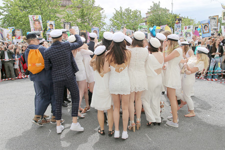 education in sweden: STOCKHOLM, SWEDEN - JUN 10, 2015: Group of happy teenagers wearing graduation caps dancing at the graduation after finishing high school at the school Globala gymnasiet, June 10, 2015, Stockholm, Sweden Editorial