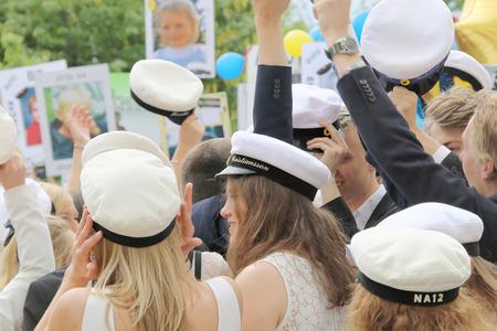 finishing school: STOCKHOLM, SWEDEN - JUN 10, 2015: Group of happy teenagers raising the graduation cap celebrating the graduation after finishing high school at the school Globala gymnasiet, June 10, 2015, Stockholm, Sweden
