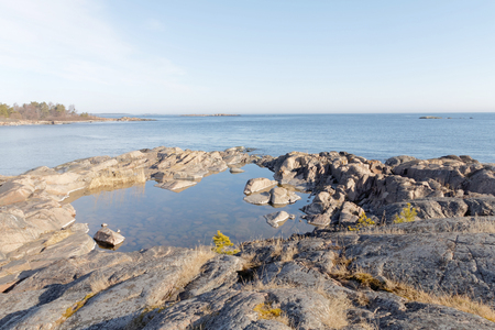 islet: Coast, cliffs, islet and ocean a sunny day during spring time in scandinavia