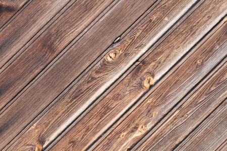 diagonal: Brown, textured plank wall oriented diagonal