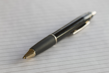 writing pad: Closeup of a pencil on a writing pad. Very short depth of focus