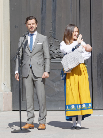 carl: STOCKHOLM, SWEDEN - JUN 06, 2016: The swedish prince Carl Philip Bernadotte and princess Sofia Hellqvist holding the newborn baby Alexander in front of the royal castle during the swedish National day