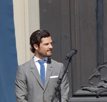carl: STOCKHOLM, SWEDEN - JUN 06, 2016: The swedish prince Carl Philip Bernadotte a in front of the door to the royal castle during the swedish National day Editorial
