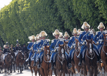 STOCKHOLM - JUN 06, 2016: The Royal guards on the horse back protecting the swedish royal family on their way to celebrate the swedish national day