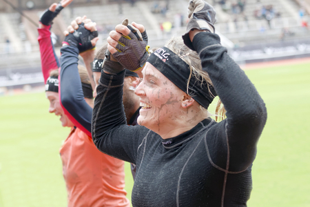 tough woman: STOCKHOLM, SWEDEN - MAY 14, 2016: Two happy woman running and raising the hands in the obstacle race Tough Viking Event in Sweden, May 14, 2016