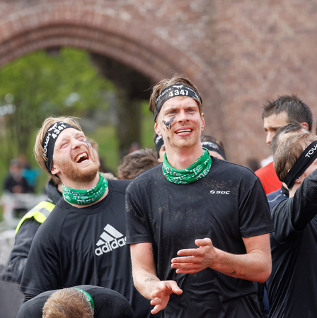 rampage: STOCKHOLM, SWEDEN - MAY 14, 2016: Two men laughing before sprinting towards the rampage obstacle in the obstacle race Tough Viking Event in Sweden, May 14, 2016 Editorial
