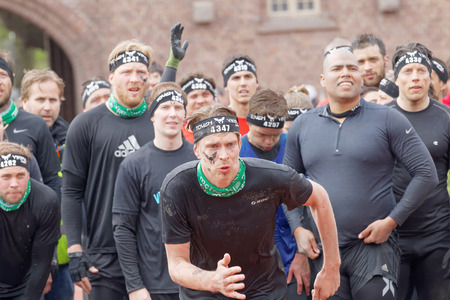 rampage: STOCKHOLM, SWEDEN - MAY 14, 2016: Group of men and woman waiting to climb the rampage obstacle in the obstacle race Tough Viking Event in Sweden, May 14, 2016