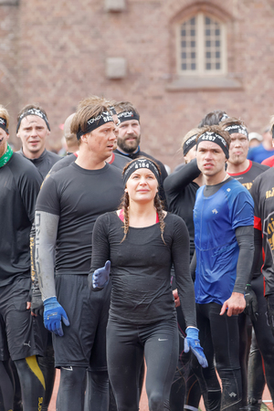 rampage: STOCKHOLM, SWEDEN - MAY 14, 2016: Woman waiting to sprint towards the rampage obstacle in the obstacle race Tough Viking Event in Sweden, May 14, 2016 Editorial
