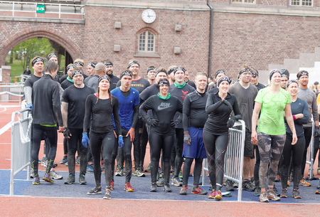 rampage: STOCKHOLM, SWEDEN - MAY 14, 2016: Group of woman and men waiting to sprint towards the rampage obstacle in the obstacle race Tough Viking Event in Sweden, May 14, 2016 Editorial