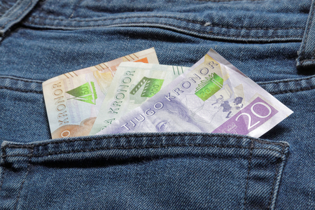 looter: Swedish bank notes sticking up from a jeans pocket Stock Photo