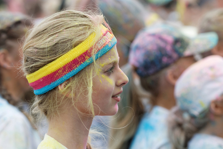bandeau: STOCKHOLM, SWEDEN - MAY 22, 2016: Head of young blonde woman wearing bandeau covered with color powder in the Color Run Event in Sweden, May 22, 2016