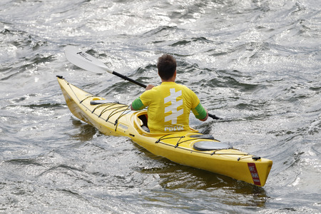 woman squirt: STOCKHOLM - JUL 02, 2016: Yellow canoe with official before the start signal in the Womens ITU World Triathlon series event July 02, 2016 in Stockholm, Sweden