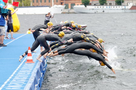 woman squirt: STOCKHOLM - JUL 02, 2016: The female competitors jump into the water after the start signal in the Womens ITU World Triathlon series event July 02, 2016 in Stockholm, Sweden Editorial