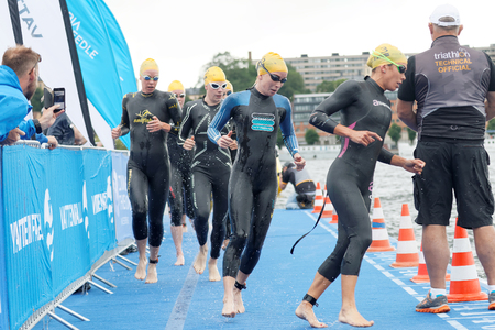 woman squirt: STOCKHOLM - JUL 02, 2016: Many female swimmer climbing up from the water in the Womens ITU World Triathlon series event July 02, 2016 in Stockholm, Sweden