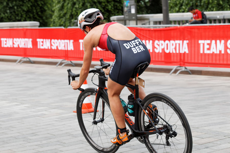 triathlete: STOCKHOLM - JUL 02, 2016: Rear side view of female triathlete cyclist Flora Duffy, Bermuda in the Womens ITU World Triathlon series event July 02, 2016 in Stockholm, Sweden Editorial