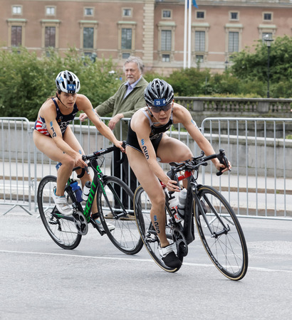 ide: STOCKHOLM - JUL 02, 2016: Two female triathlete cyclists, Sarah True and Juri Ide in the Womens ITU World Triathlon series event July 02, 2016 in Stockholm, Sweden