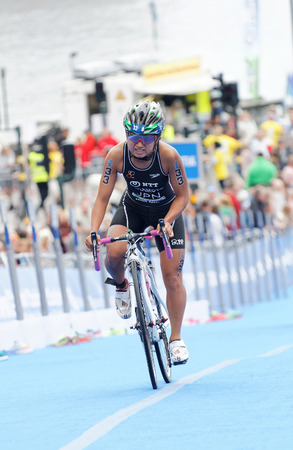 triathlete: STOCKHOLM - JUL 02, 2016: Female triathlete Aoi Kuramoto (Japan) cycling uphill in the Womens ITU World Triathlon series event July 02, 2016 in Stockholm, Sweden Editorial