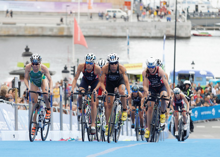 triathlete: STOCKHOLM - JUL 02, 2016: Large group of female triathlete cyclists cycling uphill in the Womens ITU World Triathlon series event July 02, 2016 in Stockholm, Sweden Editorial
