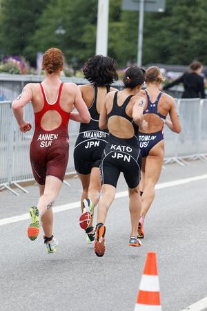 STOCKHOLM - JUL 02, 2016: Rear view of group of running triathletes in the Womens ITU World Triathlon series event July 02, 2016 in Stockholm, Sweden Redakční