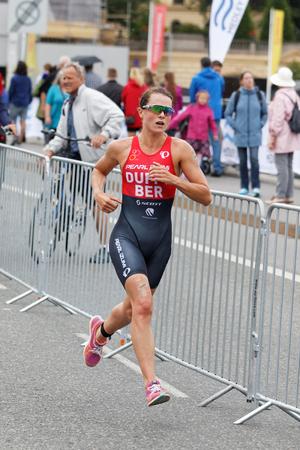 STOCKHOLM - JUL 02, 2016: Leading triathlete Flora Duffy (BER) running in the Womens ITU World Triathlon series event July 02, 2016 in Stockholm, Sweden