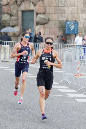 helen: STOCKHOLM - JUL 02, 2016: Triathletes Andrea Hewitt and Helen Jenkins running in the Womens ITU World Triathlon series event July 02, 2016 in Stockholm, Sweden