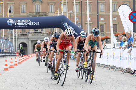 triathlete: STOCKHOLM - JUL 02, 2016: Group of female triathlete cyclists in front of the royale castle in the Womens ITU World Triathlon series event July 02, 2016 in Stockholm, Sweden Editorial