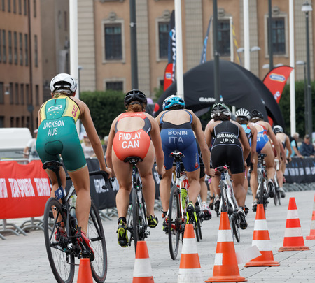 STOCKHOLM - JUL 02, 2016: Rear view of group of triathlete cyclists Jackson, Finlay, Bonin, Kuramoto and royal castle in the Womens ITU World Triathlon series event July 02, 2016 in Stockholm, Sweden