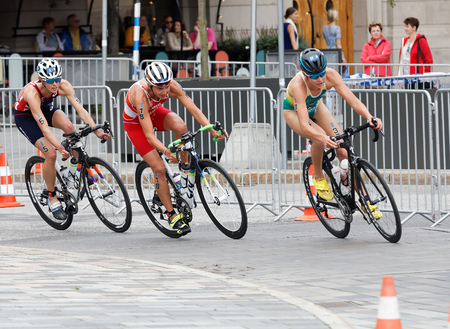 triathlete: STOCKHOLM - JUL 02, 2016: Side view of group of female triathlete cyclists in the Womens ITU World Triathlon series event July 02, 2016 in Stockholm, Sweden Editorial
