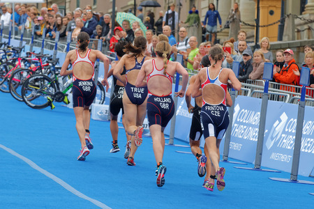 STOCKHOLM - JUL 02, 2016: Rear view of group of running triathlete in the transition zone in the Womens ITU World Triathlon series event July 02, 2016 in Stockholm, Sweden Editorial