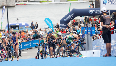 cycles: STOCKHOLM - JUL 02, 2016: Group of triathletes running with cycles in the transition zone in the Womens ITU World Triathlon series event July 02, 2016 in Stockholm, Sweden Editorial