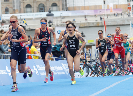 ide: STOCKHOLM - JUL 02, 2016: Group of triathletes running in the transition zone in the Womens ITU World Triathlon series event July 02, 2016 in Stockholm, Sweden