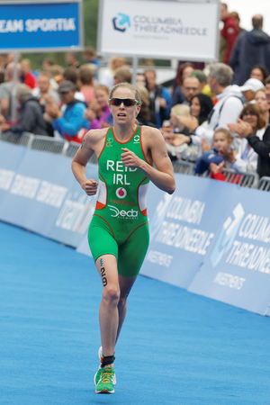 triathlete: STOCKHOLM - JUL 02, 2016: Triathlete Aileen Reid (IRL) running at the finish in the Womens ITU World Triathlon series event July 02, 2016 in Stockholm, Sweden Editorial